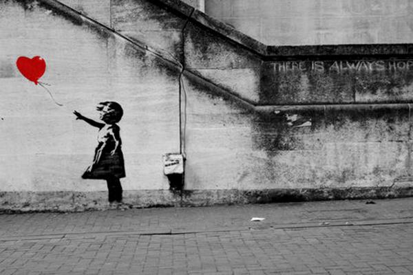 """""""La nena i el globus, pintada per Banksy a la ciutat de Londres l'any 2002"""""""